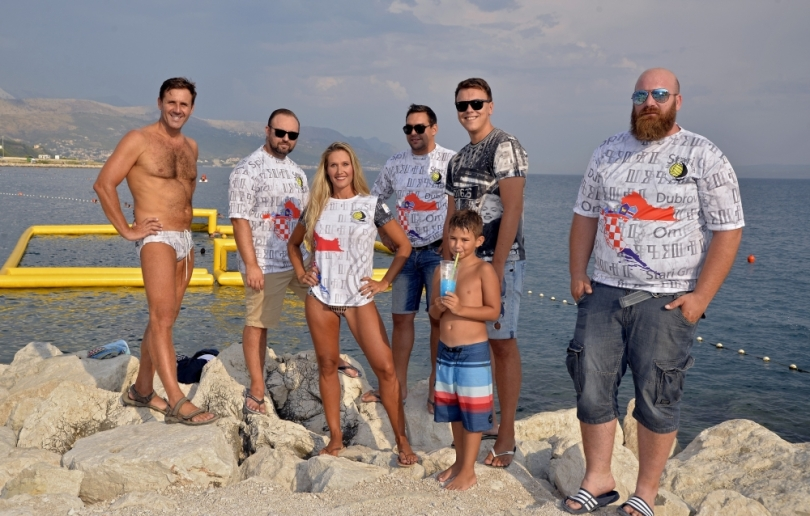 group photo in wpc shirts and speedos
